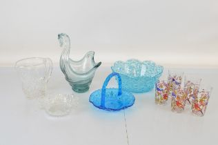 A collection of glassware, including coloured fruit bowls, tumblers, blown glass water jug, etc
