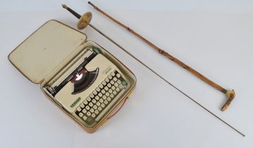An Olympic Slendid 66 typewriter, together with a Spanish rapier and a bone handle walking stick (