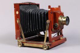 A Thornton Pickard Imperial Triple Extension Half Plate Field Camera, tapered chamfered-corner black