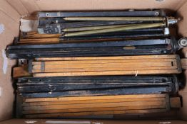 A Collection of Wooden and Metal Tripods and Legs, two lightweight ebonised black tripods together