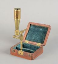 A mid-19th Century lacquered brass Cary Pocket Compound Monocular Microscope, signed 'Cary, London',