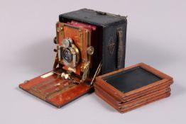 A Sanderson Quarter Plate Hand & Stand Camera, serial no 2972, circa 1901, red square-cornered