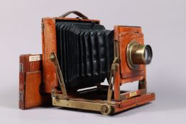 A Thornton Pickard Half Plate Field Camera, tapered square-cornered black bellows, triple extension,