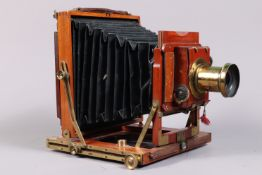 A Half Plate Mahogany and Brass Field Camera, tapered square-cornered black bellows, double