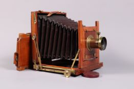 A Mahogany and Brass Half Plate Field Camera, square cornered maroon bellows, double extension, rear
