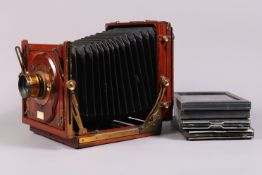 A Sanderson Half Plate Field Camera, serial no 13876, chamfered bellows, double extension, screen,