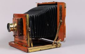 A Half Plate Mahogany and Brass Field Camera, tapered chamfered-corner black bellows, triple
