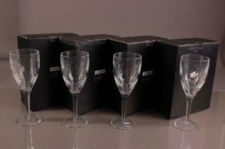 A set of Modern Waterford Crystal cut glass wine glasses designed by John Rocha, 25cm, in four boxes