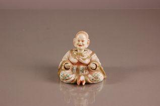 A late 19th century Ernest Bohne & Sohne porcelain Chinese Pagoda nodding figure, 10.5cm,