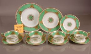 A part Wedgwood pottery dinner service, in green and white and heightened with gilt decration,