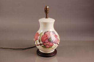 A modern Moorcroft pottery lamp base, 35cm, cream ovoid body with tube lined floral branch, fitted