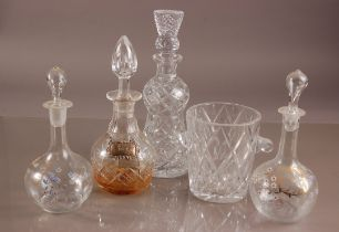 Four Victorian and later glass decanters and a cut glass ice bucket, including a pair with painted