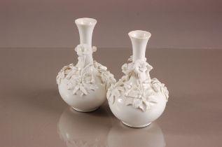 A pair of Victorian Stevensons & Hancock blanc de chine porcelain vases, 16cm, globular with tapered