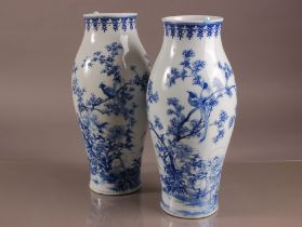 A pair of early 20th century Japanese blue and white porcelain vases, 37cm, nicely painted with a