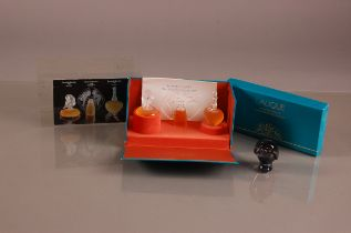 A 1990s Lalique Glass the Ultimate Collection perfume set, the three scent bottles with contents