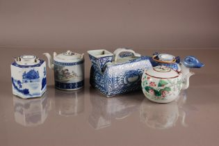 Four Oriental porcelain teapots and a Chinese porcelain iron, the blue and white Chinese porcleain