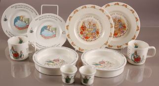 Ten modern Wedgwood pottery Peter Rabbit items, including two egg cups, feeding bowls, mugs, and two