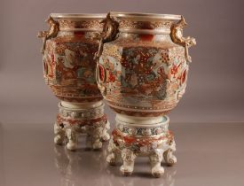 A pair of first half 20th century Japanese Satsuma style pottery jars and stands, 45 cm high, with