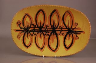 A c1970s large terracotta centrepiece dish, 57cm wide, stamped to underside P. Begley RCA