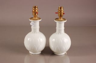 A pair of second half 20th century Royal Copenhagen porcelain lamp bases, 26cm high, blanc de