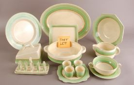An Art Deco period Newport Pottery and Royal Staffordshire part dinner service by Clarice Cliff,