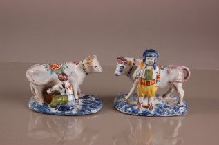 A pair of early 20th century French faience pottery figural groups, 13cm wide, one modelled a man