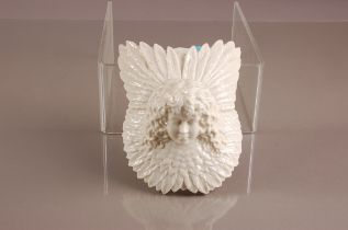 A Victorian W.H. Goss porcleain wall pocket, 18.5cm, with head of a young child surrounded by