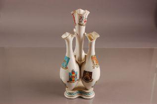 A Victorian W.H. Goss porcelain epergne, AF, 31cm, withLondon Borough emblems, damaged