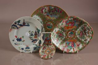 Four 19th century and later Chinese porcelain dishes, three in the Canton palette with painted