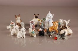 A collection of 16 second half 20th century ceramics pussy cats, including a Royal Crown Derby