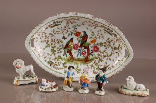 Seven 19th and 20th century porcelain items, including a damaged and staple repaired oval dish