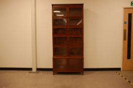 A first half 20th century mahogany stacking bookcase, 206cm high and 89cm wide, with six glazed