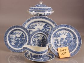 A modern Wedgwood pottery Willow pattern dinner service, six dinner, side, dessert plates, soup