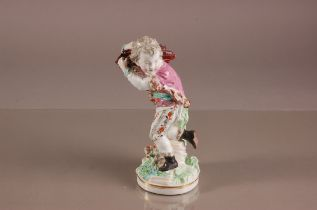 A 19th century British porcelain figure of a young woodsman, proabably Derby, modelled walking