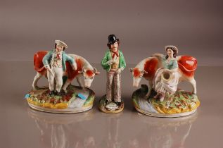 A pair of Victorian Staffordshire pottery figures and another, AF, including a man and a woman