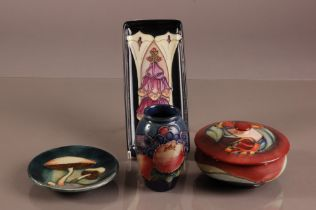 Four second half 20th century Moorcroft pottery items, including a circular box and cover, a small