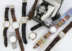 A small group of watches, including two Swatch watches in a Swatch box, a Tissot, a Seiko quartz,