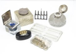Three Victorian and early 20th Century glass and silver ink wells, together with a small silver