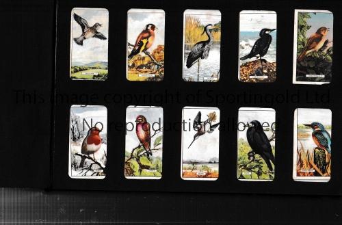 CIGARETTE CARD ALBUM A burgundy coloured cigarette card album with 178 cards of British Birds