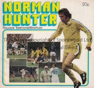 NORMAN HUNTER Autographed testimonial brochure, signed label laid down on the team picture in the