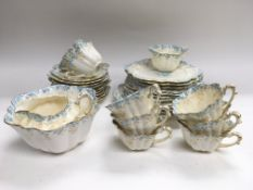 A scalloped tea set blue and gilt decoration on a