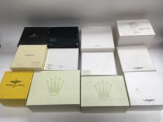 A collection of designer watch boxes and jewellery