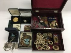 A collection of costume jewellery and coins. NO RE