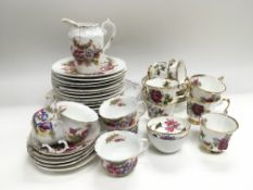 Two decorative china tea sets decorated with flowe