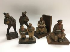 Five carved wooden figures including some WW1 sold
