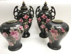A pair of vases and covers decorated with flowers