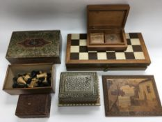 A wooden chess set plus extra pieces, a folding mu
