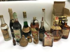 A collection of bottled spirits including Dimple H