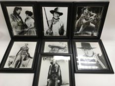 Seven framed black and white photographic prints o