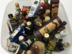 A collection of miniature liqueurs whisky and othe